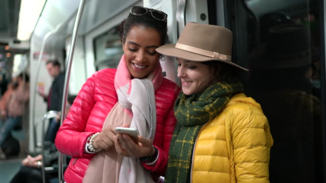 tourists using smartphone at the subway train - hot pink stock videos & royalty-free footage