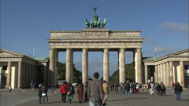 Tourists view the Brandenburg Gate.