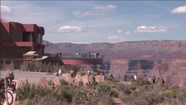 tourists view the grand canyon from the skywalk overlook. - grand canyon national park stock videos & royalty-free footage