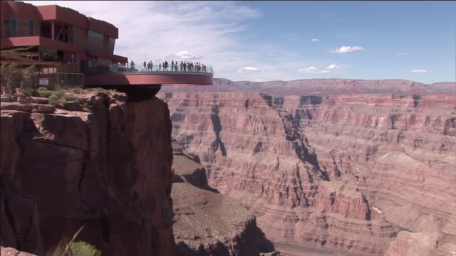 tourists view the grand canyon from the skywalk overlook. - grand canyon video stock e b–roll