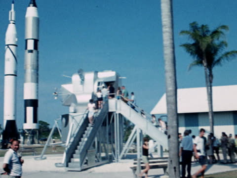 Tourists view the Saturn 5 rocket and Apollo 11 spacecraft in the grounds of NASA's Cape Kennedy launch base