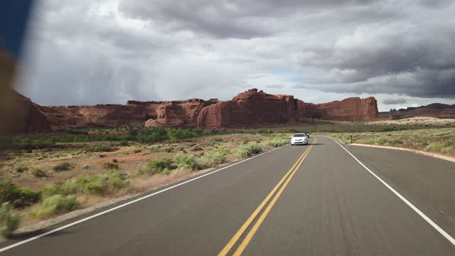 tourists visit arches national park in utah area. - utah stock videos & royalty-free footage