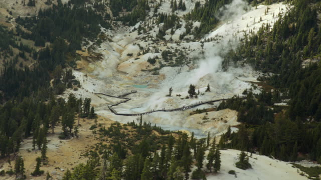 Tourists visit Bumpass Hell, a hot springs area in Lassen Volcanic National Park.