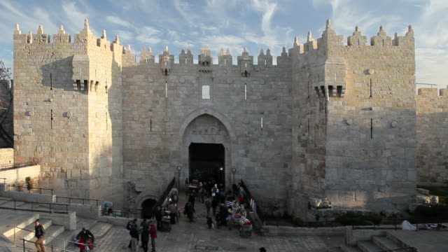 Tourists visit Damascus Gate in Old City Jerusalem.
