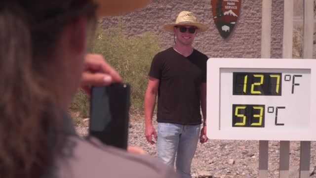 """tourists visit death valley national park in eastern california. known as """"the hottest place on earth,"""" the temperature has hit 128 degrees... - death valley national park stock videos & royalty-free footage"""