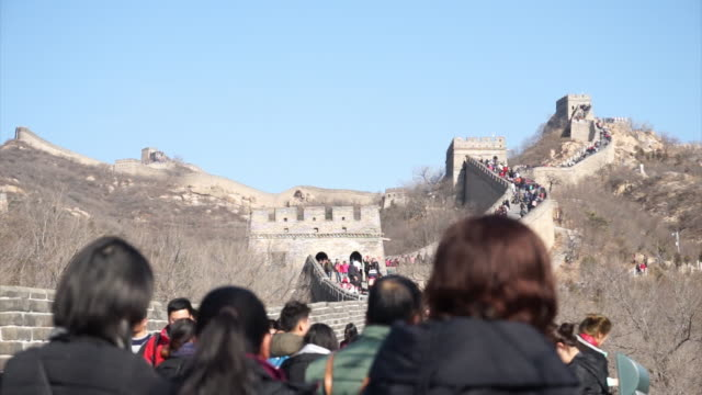 tourists visit famous badaling great wall on feb 18, 2017 in beijing, china. - badaling great wall stock videos & royalty-free footage