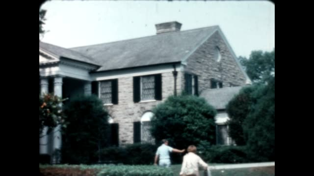 Tourists visit Graceland the home of Elvis Presley who had passed away about a year prior to this home movie