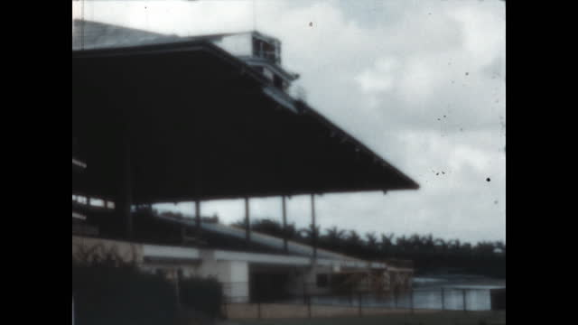 tourists visit hileah park casino and racetrack in the late 1940's. - 1940 1949 video stock e b–roll
