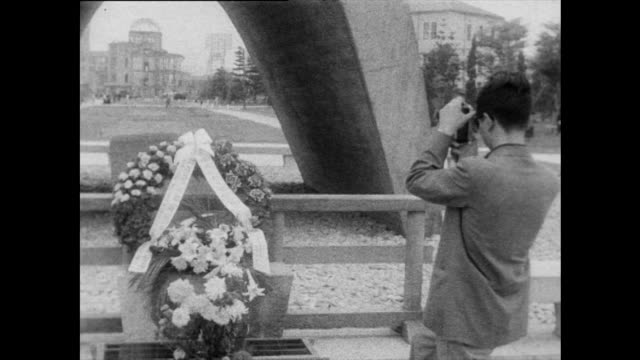 tourists visit memorials in hiroshima peace park; 1958 - sad old asian man stock videos & royalty-free footage