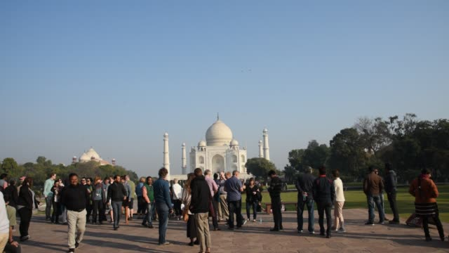 tourists visit taj mahal a unesco world heritage site in agra, india. - agra video stock e b–roll
