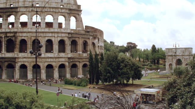 tourists visit the coliseum in rome. - 2003 stock videos & royalty-free footage