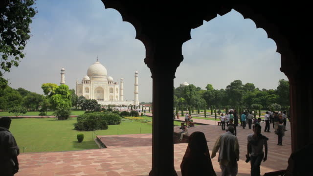tourists visit the grounds of taj mahal. - taj mahal stock videos and b-roll footage