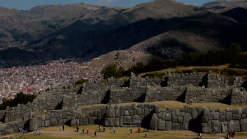 tourists visit the inca ruins of sacsayhuaman on may 23, 2018 in cusco, peru. at 3701 meters above sea level the ancient site sits looking down from... - unesco world heritage site点の映像素材/bロール