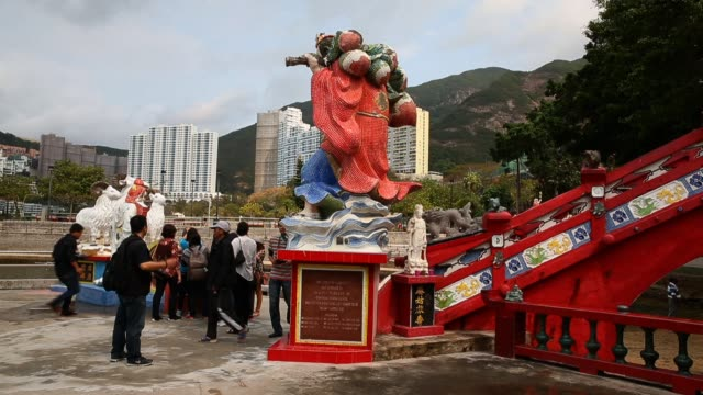 Tourists visit the Kwun Yam Shrine At Repulse Bay on March 20 2013 in Hong Kong Hong Kong Located at the Southern end of Repulse Bay the Taoist...