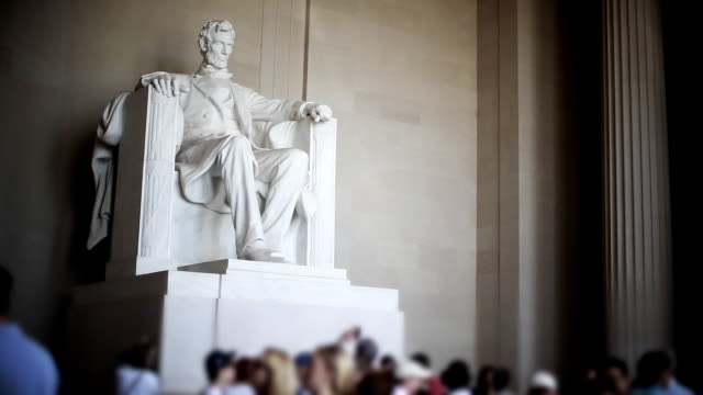 Tourists visit the Lincoln Memorial.