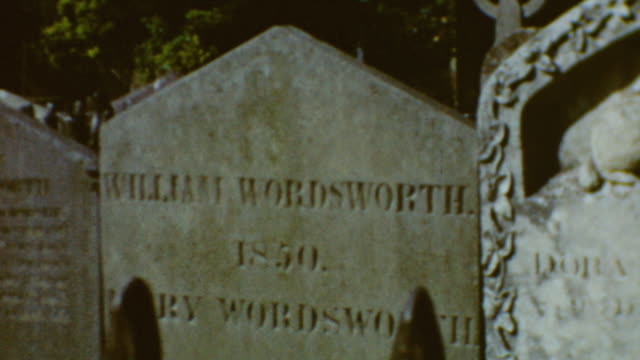 tourists visit the poet wordsworth home / tombstone of wordsworth in grasmere / english lake district / william wordsworth home and grave on... - poet stock videos & royalty-free footage