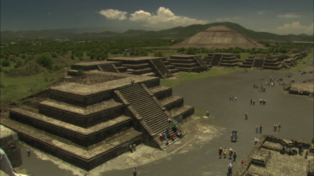 Tourists visit the pyramids in Teotihuacan.