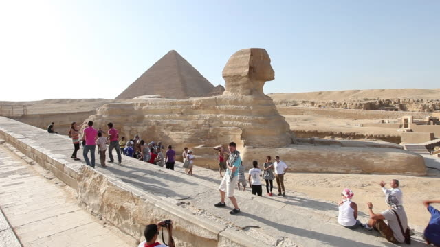 Tourists visit the Sphinx and pyramids in Egypt.