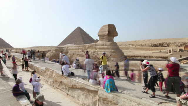 Tourists visit the Sphinxes and pyramids in Egypt.