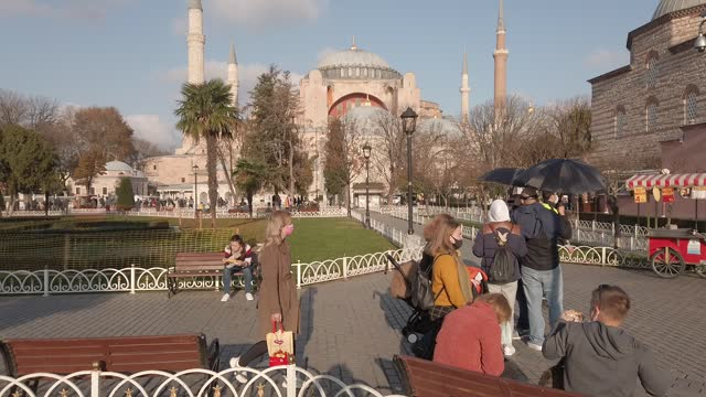 tourists visit the sultanamet square and hagia sophia grand mosque during a national weekend coronavirus lockdown on december 06 in istanbul, turkey.... - weekday stock videos & royalty-free footage