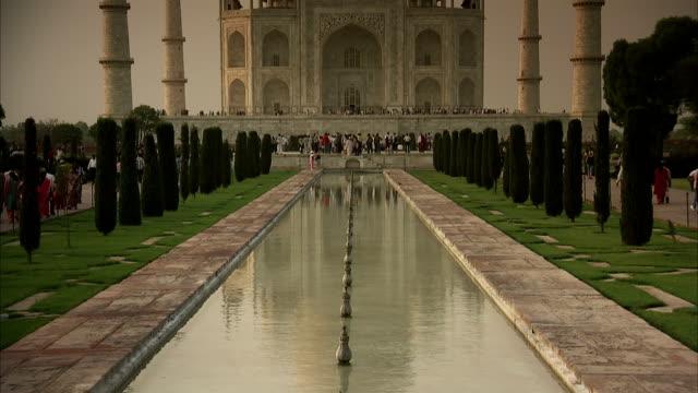 Tourists visit the Taj Mahal.
