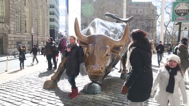 Tourists visit the Wall Street Bull near the New York Stock Exchange in New York US on Friday Feb 26 2016 Photographer Michael Nagle/Bloomberg Shots...