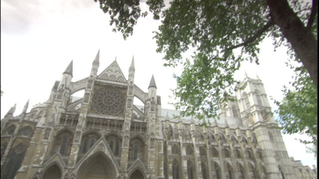 Tourists visit the Westminster Abbey in London.
