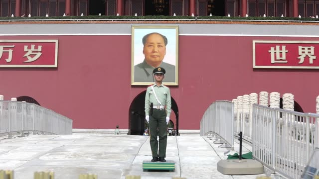 tourists visit tiananmen square in beijing china on tuesday sept 27 red flags fly at tiananmen gate a paramilitary police officer stands guard as... - mao stock videos and b-roll footage