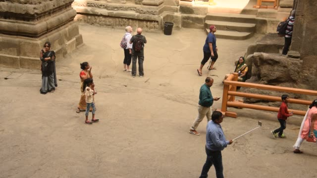 stockvideo's en b-roll-footage met tourists visit to the ellora caves, unesco world heritage side. - grot