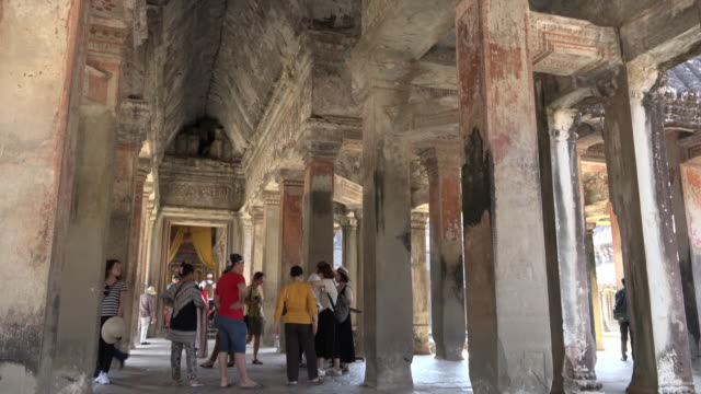 td / tourists visiting angkor wat temple inside - angkor wat stock videos and b-roll footage