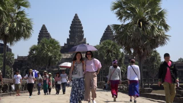 Tourists visiting Angkor Wat temple