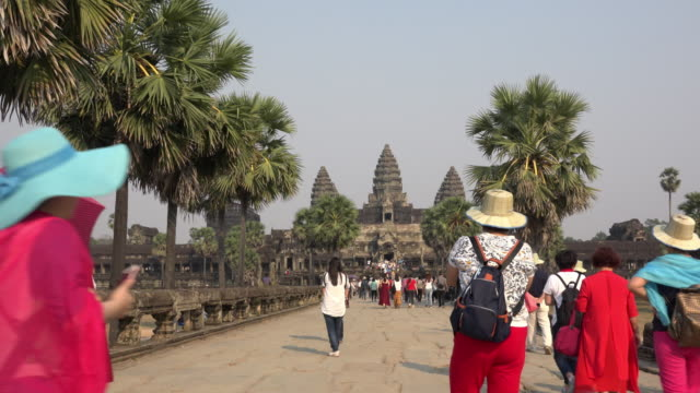tourists visiting angkor wat temple - cambodia stock videos and b-roll footage