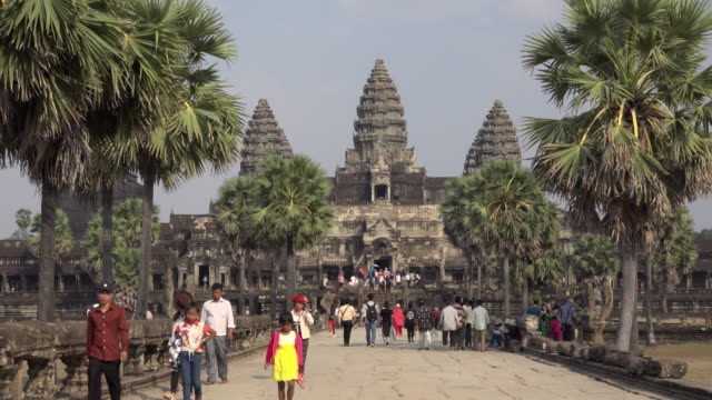 tourists visiting angkor wat temple - angkor wat stock videos and b-roll footage