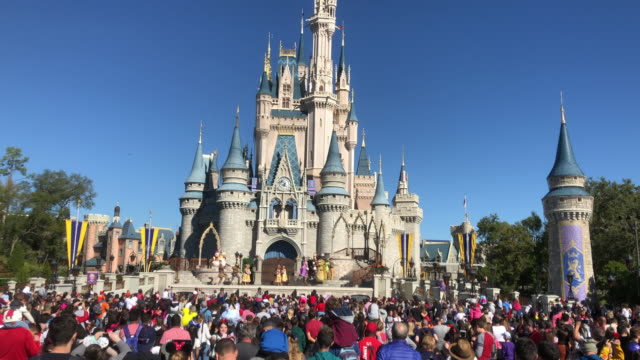 tourists visiting disney's magic kingdom in orlando florida - disney stock videos and b-roll footage