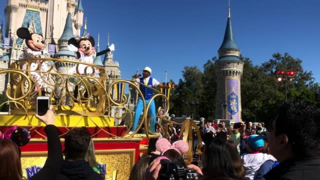 tourists visiting disney's magic kingdom in orlando, florida. - disney stock videos & royalty-free footage