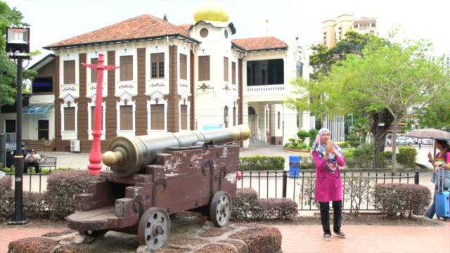 Tourists Visiting Famosa - A Portuguese Fortress Located In Malacca, Malaysia