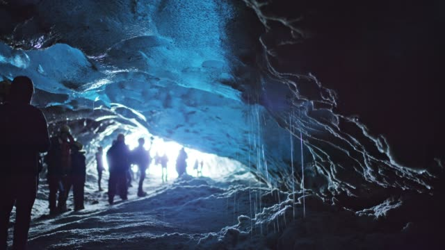 ms tourists visiting ice cave,iceland - cave stock videos & royalty-free footage