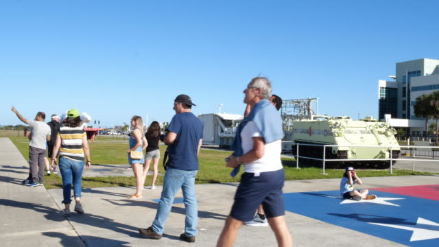 tourists visiting kennedy space center - kennedy space center stock-videos und b-roll-filmmaterial
