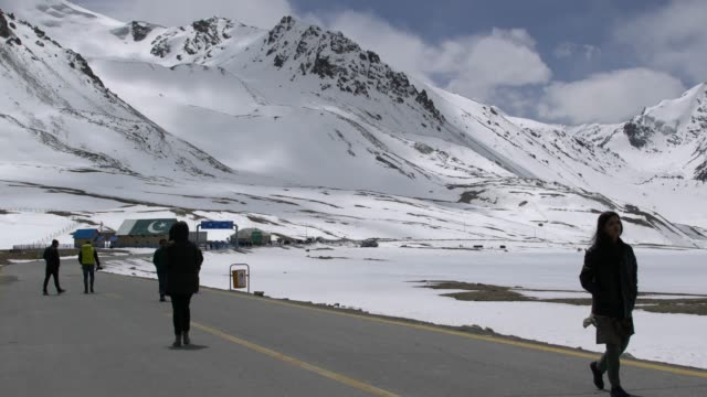 tourists visiting khunjerab pass, the highest paved international border crossing in the world, between pakistan and china - china east asia stock videos & royalty-free footage