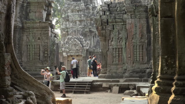 tourists visiting ta prohm temple - angkor wat stock videos and b-roll footage