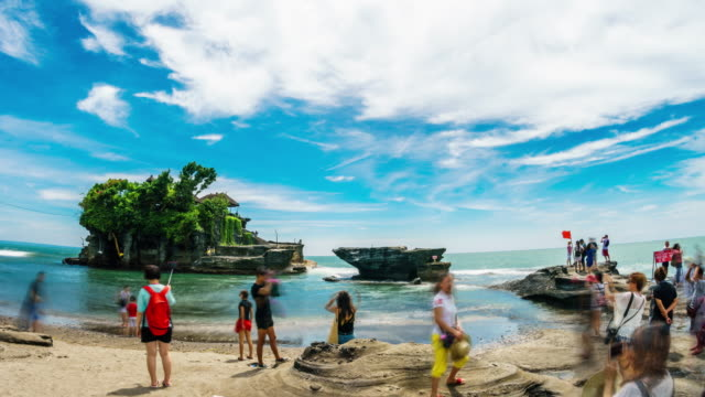 Tourists visiting Tanah Lot temple Bali Indonesia time lapse