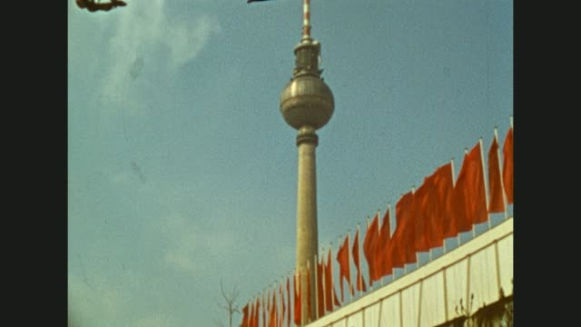 """tourists visiting the city of berlin / capital of germany and the gdr / famous buildings at the alexanderplatz like hotel """"stadt berlin"""" and tv tower... - alexanderplatz stock videos & royalty-free footage"""