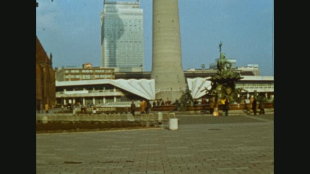 """tourists visiting the city of berlin / capital of germany and the gdr / famous building at the alexanderplatz hotel """"stadt berlin"""" / views out of the... - alexanderplatz stock videos & royalty-free footage"""