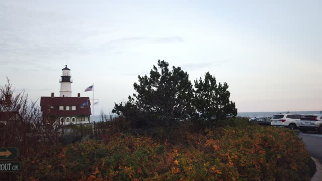 tourists visiting the lighthouse at the fort williams park after sunset amid the 2020 global coronavirus pandemic. - horizon over water stock videos & royalty-free footage