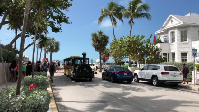 tourists visiting the southernmost city key west in florida usa - key west stock videos & royalty-free footage