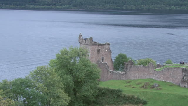 ZO Tourists visiting Urquhart Castle beside Loch Ness / Highlands, Scotland, United Kingdom
