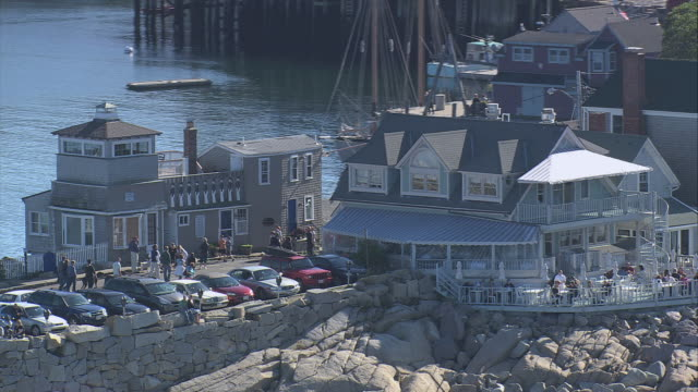 aerial tourists visiting waterfront establishments / rockport, massachusetts, united states - rockport massachusetts stock videos & royalty-free footage