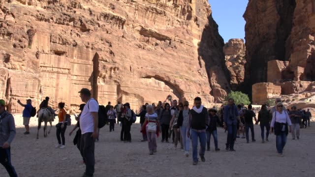 tourists visitng the breathtaking monuments of petra in jordan - 6th century bc stock videos and b-roll footage