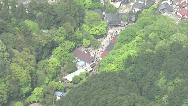 Tourists wait at the Kiyotaki station as they wait to ride the funicular at Mount Takao.