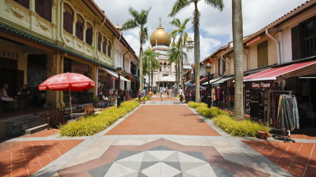 tourists walk along a tiled path at the sultan mosque in kampong glam. - sultan mosque singapore stock videos and b-roll footage